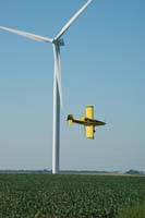 crop dusting near turbines
